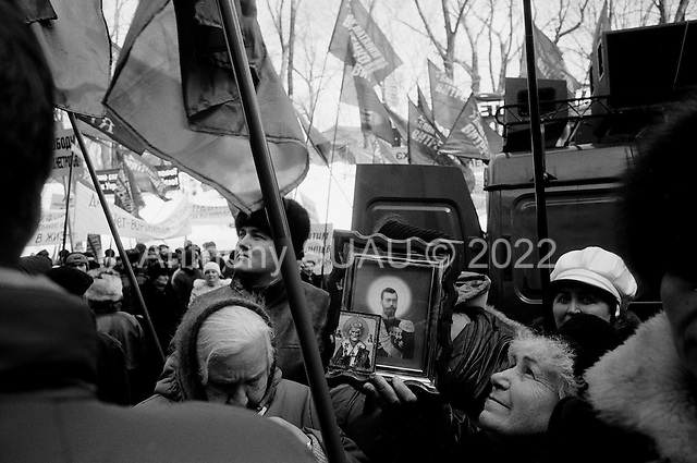 Kiev, ukraine.March 14, 2006..Supporters of the Party of Progressive Socialists, who's candidate is Nataliya Vitrenko, take to the streets of central Kiev to support their candidate and denounce the Government of President Victor Yushchenko. Nataliya Vitrenko claims that she will receive gas for the Ukraine from Russia for $45 a barrel...Almost daily there are street parades for one party or another down the central street of Kreschatik as elections approach. Civilians are confused by all the candidates and try and go about their daily lives.
