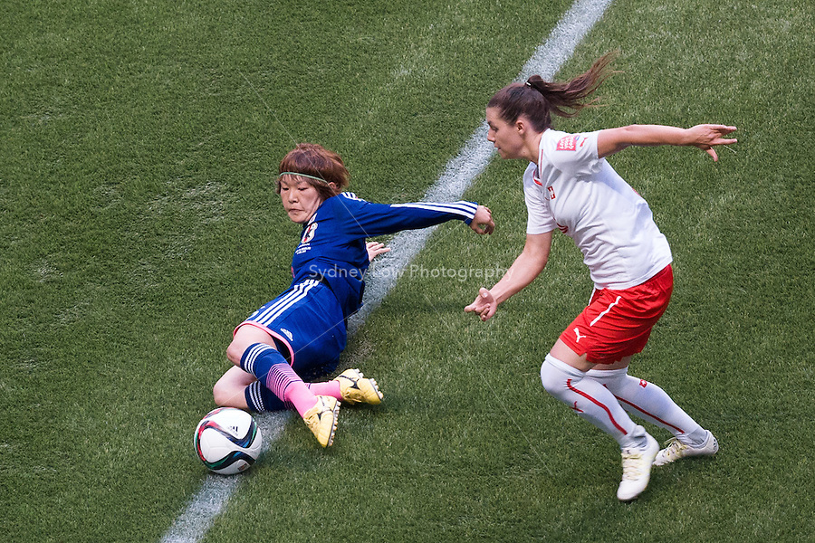 June 8, 2015: Mizuho SAKAGUCHI of Japan kicks the ball during a Group C match at the FIFA Women's World Cup Canada 2015 between Japan and Switzerland at BC Place Stadium on 8 June 2015 in Vancouver, Canada. Sydney Low/AsteriskImages