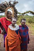 TANZANIA, a portrait of three Maasai Kids in Ngorongoro Conservation Area,