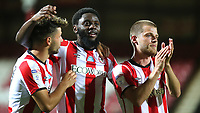 Emiliano Marcondes, Josh DaSilva and Mathias Jensen celebrate Brentford's victory at the final whistle during Brentford vs Swansea City, Sky Bet EFL Championship Play-Off Semi-Final 2nd Leg Football at Griffin Park on 29th July 2020