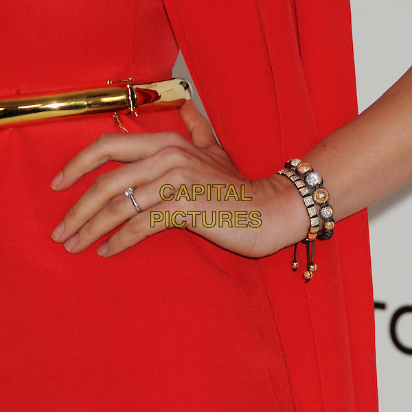 Petra Nemcova's hand.20th Annual Elton John Academy Awards Viewing Party held at West Hollywood Park, West Hollywood, California, USA..February 26th, 2012.oscars on hip red gold belt bracelet diamond jewellery jewelry .CAP/ADM/BP.©Byron Purvis/AdMedia/Capital Pictures.