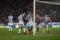 Huddersfield Town's Aaron Mooy clears off the goal line<br /> <br /> Photographer Rob Newell/CameraSport<br /> <br /> The Premier League - Huddersfield Town v West Ham United - Saturday 13th January 2018 - John Smith's Stadium - Huddersfield<br /> <br /> World Copyright &copy; 2018 CameraSport. All rights reserved. 43 Linden Ave. Countesthorpe. Leicester. England. LE8 5PG - Tel: +44 (0) 116 277 4147 - admin@camerasport.com - www.camerasport.com
