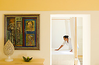 One of the twenty bedrooms at Villa Cenci is being prepared for arriving guests