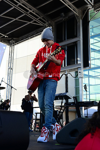 SUNRISE, FL - DECEMBER 20: Austin Mahone performs at Y100's Pre-Show at the Jingle Ball Village on the plaza at the BB&T Center on December 20, 2013 in Sunrise, Florida. . © MPI10/MediaPunch Inc