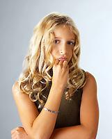 Perplexed teenage girl.