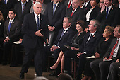 Vice President Mike Pence walks past former U.S. President George W. Bush, as well as his wife former first lady Laura Bush, brother former Florida Governor Jeb Bush, Jeb's wife Columba Bush and brother Marvin Bush as Pence takes the podium to speak about the president's father former President George H.W. Bush during ceremonies in the U.S. Capitol Rotunda in Washington, U.S., December 3, 2018. REUTERS/Jonathan Ernst/Pool