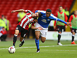 Stefan Scougall of Sheffield Utd tussles with Dean Moore of Peterborough Utd during the League One match at Bramall Lane Stadium, Sheffield. Picture date: September 17th, 2016. Pic Simon Bellis/Sportimage