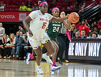 COLLEGE PARK, MD - FEBRUARY 03: Ashley Owusu #15 of Maryland moves away from Nia Clouden #24 of Michigan State during a game between Michigan State and Maryland at Xfinity Center on February 03, 2020 in College Park, Maryland.