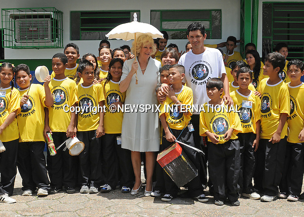 "CAMILLA, DUCHESS OF CORNWALL.Visits the Municipal Centre for Art and Education on a poor area of Manaus where the Duchess had a touching moment with one of the children of ""Curumim na Lata"" (Children of the can-percussion) holding his hand..The Duchess also watched a fashion show, an experimental youth orchestra and a ballet. The centre seeks to use recycled goods in innovative ways..The clothes modeled by local girls in the fashion have been made from recycled material including bottle lids and crisp packets.The Duchess was wearing an Anna Valentine silk shift dress (Pale blue with white beaded detail)..Forth day Brazil on the second leg of their South American Tour, Manaus, Brazil_14/03/09......Mandatory Credit Photo: ©DIAS-NEWSPIX INTERNATIONAL..Please telephone : +441279324672 for usage fees..**ALL FEES PAYABLE TO: ""NEWSPIX INTERNATIONAL""**..IMMEDIATE CONFIRMATION OF USAGE REQUIRED:.Newspix International, 31 Chinnery Hill, Bishop's Stortford, ENGLAND CM23 3PS.Tel:+441279 324672  ; Fax: +441279656877.Mobile:  07775681153.e-mail: info@newspixinternational.co.uk"