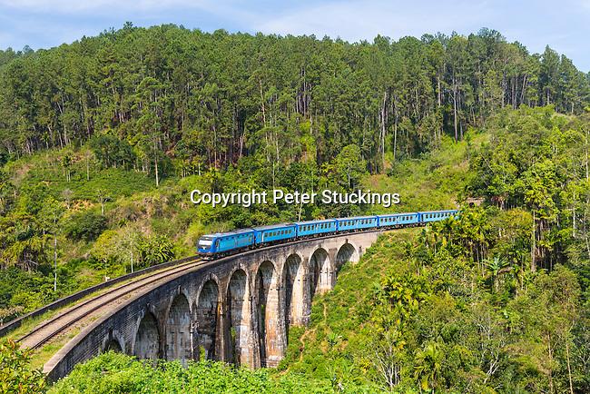 The Badulla to Kandy express crosses the Nine Arches Bridge at Ella, Sri Lanka