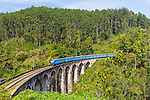 The Badulla to Kandy express crosses the Nine Arches Bridge at Ella, Sri Lanka