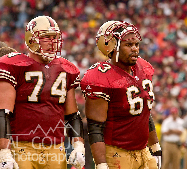 San Francisco 49ers tackle Dave Fiore (74) and tackle Derrick Deese (63) make comments on Sunday, December 16, 2001, in San Francisco, California. The 49ers defeated the Dolphins 21-0.