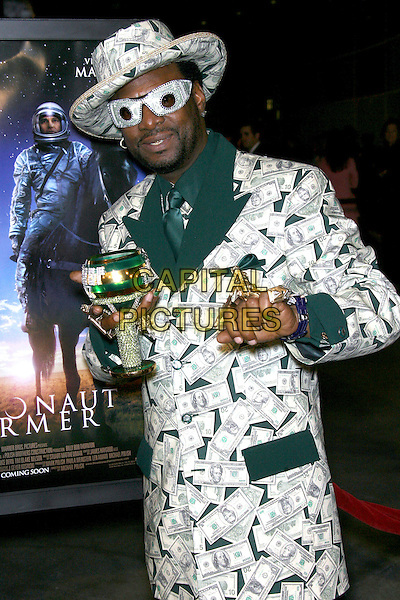 """BISHOP DON MAGIC JUAN.""""The Astronaut Farmer"""" World Premiere - Arrivals held at the Cinerama Dome, Hollywood, California , USA, .20 February 2007..half length hat glasses suit dollars money $ patterned print fabric bling jewellery rings cup.CAP/ADM/ZL.©Zach Lipp/AdMedia/Capital Pictures."""