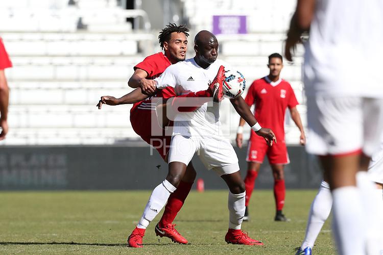 Orlando, Florida - Wednesday January 17, 2018: Mamadou Guirassy and Thomas Vancaeyezeele. Match Day 3 of the 2018 adidas MLS Player Combine was held Orlando City Stadium.