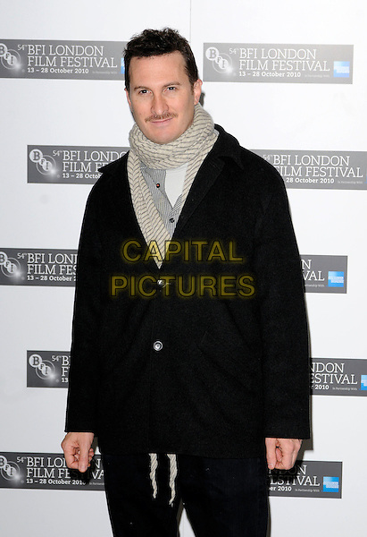 "DARREN ARONOFSKY.The ""Black Swan"" press conference & photocall, London Film Festival, Day 10, Berkeley hotel, London, England..October 22nd, 2010.LFF half length black coat jacket grey gray scarf moustache mustache facial hair.CAP/CAN.©Can Nguyen/Capital Pictures."