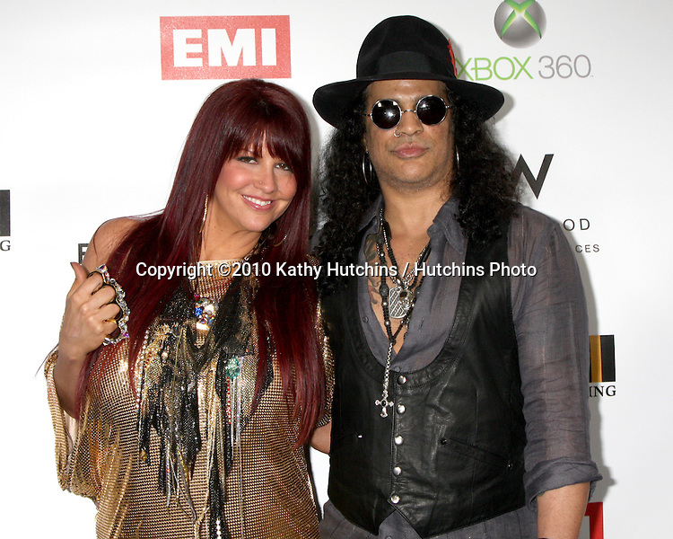 Slash & Perla Hudson.arriving at the EMI Post Grammy Party 2010.W Hotel Hollwood.Los Angeles, CA.January 31, 2010.©2010 Kathy Hutchins / Hutchins Photo....
