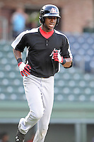 Outfielder Lewis Brinson (27) of the Hickory Crawdads in a game against the Greenville Drive on Friday, June 7, 2013, at Fluor Field at the West End in Greenville, South Carolina. Brinson is the No. 12 prospect of the Texas Rangers, according to Baseball America and was a first-round pick (29th overall) in the 2012 First-Year Player Draft. Greenville won the resumption of this May 22 suspended game, 17-8. (Tom Priddy/Four Seam Images)