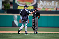 Scranton/Wilkes-Barre RailRiders manager Jay Bell (22) argues a call with umpire Richard Riley during an International League game against the Rochester Red Wings on June 25, 2019 at Frontier Field in Rochester, New York.  Rochester defeated Scranton 10-9.  (Mike Janes/Four Seam Images)