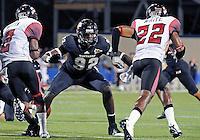 Florida International University football player defensive line Paul Crawford (92) plays against the University of Louisiana-Lafayette on September 24, 2011 at Miami, Florida. Louisiana-Lafayette won the game 36-31. .
