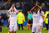 Pictured (L-R): Ki Sung-Yueng and Kyle Naughton of Swansea City thank away supporters Saturday 27 August 2016<br />