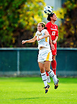 14 October 2010: University of Hartford Hawks defender Michele DeSanti, a Junior from Meriden, CT, jumps to get a header against University of Vermont Catamount forward Jessica Becker, a Senior from Woodbridge, CT,  at Centennial Field in Burlington, Vermont. The Hawks defeated the Lady Cats 6-2 in America East play. Mandatory Credit: Ed Wolfstein Photo