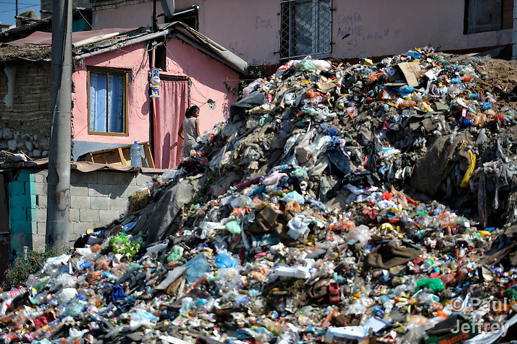 Garbage is piled up to the door of a Roma girl's house in the Maxsuda neighborhood of Varna, Bulgaria.