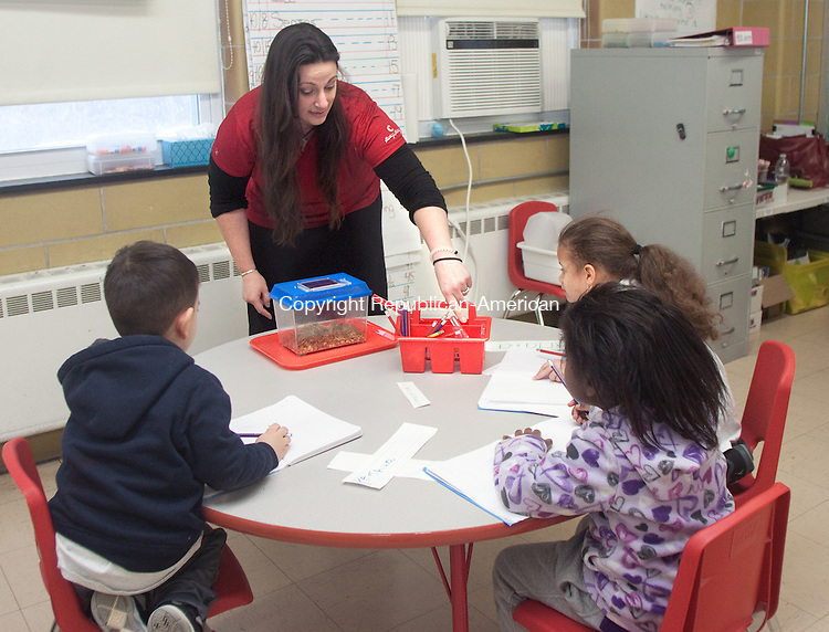 WATERBURY CT- JANUARY 07 2015 010715DA02- Connecticut Science Center Education Outreach Coordinator, Courtney Bauknecht, instructs kindergarden students of the city's new Brass City Charter School to closely examine crickets during a program that was a collaboration between the Connecticut Science Center,  Brass City Charter School and The Leever Foundation.<br /> Darlene Douty Republican American