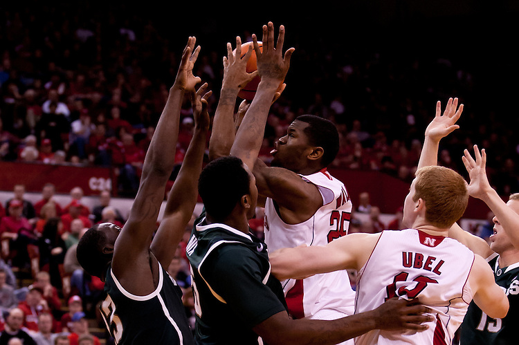 31 December 2011: Caleb Walker #25 of the Nebraska Cornhuskers puts up the shot against the Michigan State Spartans during the second half at the Devaney Sports Center in Lincoln, Nebraska. Michigan State defeated Nebraska 68 to 55.