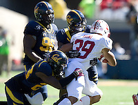 Steve Williams of California and Josh Hill of California tackle Kelsey Young of Stanford during 115th Big Game at Memorial Stadium in Berkeley, California on October 20th, 2012.  Stanford defeated California, 21-3.