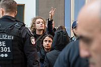 Etwa ein dutzend Aktivisten der Kampagne #Riseup4Rojava stoerten am Mittwoch den 16. Oktober 2019 die Regierungspressekonferenz im Haus der Bundespressekonferenz in Berlin und verlasen Erklaerungen gegen die Invasion der Tuerkei in Nordsyrien. Sie forderten die Bundesregierung auf, kurdische Fahnen, Symbole und Organisationen nicht laenger zu verbieten keine Waffen an die Tuerkei zu verkaufen.<br /> Alle Aktivisten wurden von der Polizei abgefuehrt.<br /> 16.10.2019, Berlin<br /> Copyright: Christian-Ditsch.de<br /> [Inhaltsveraendernde Manipulation des Fotos nur nach ausdruecklicher Genehmigung des Fotografen. Vereinbarungen ueber Abtretung von Persoenlichkeitsrechten/Model Release der abgebildeten Person/Personen liegen nicht vor. NO MODEL RELEASE! Nur fuer Redaktionelle Zwecke. Don't publish without copyright Christian-Ditsch.de, Veroeffentlichung nur mit Fotografennennung, sowie gegen Honorar, MwSt. und Beleg. Konto: I N G - D i B a, IBAN DE58500105175400192269, BIC INGDDEFFXXX, Kontakt: post@christian-ditsch.de<br /> Bei der Bearbeitung der Dateiinformationen darf die Urheberkennzeichnung in den EXIF- und  IPTC-Daten nicht entfernt werden, diese sind in digitalen Medien nach §95c UrhG rechtlich geschuetzt. Der Urhebervermerk wird gemaess §13 UrhG verlangt.]