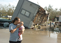 Collier,Everglades City, Fl. 10/24/2005--WILMA 25-- Shannon Potts kisses her daughter Ella Potts, 4 months, while surveying the damage to their families cabin in Glades Haven in Everglades City after Hurricane Wilma hit the west Florida Coast. Shannon and her husband Andrew live in Bonnita Springs and own a cabin in Everglades city.  PHOTOS 14 OF IMAGES STAFF MICHAEL SPOONEYBARGER