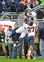 02 November 2013:  Penn State WR Allen Robinson (8) makes a leaping, twisting catch over Illinois CB Eaton Spence (27). The Penn State Nittany Lions defeated the Illinois Illini 24-17 in OT at Beaver Stadium in State College, PA.