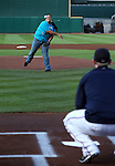 Douglas High junior Teena Simpson throws out the first pitch before a minor league baseball game in Reno, Nev., on Sunday, Aug. 25, 2013. The Salt Lake Bees defeated the Reno Aces 9-1. <br /> Photo by Cathleen Allison