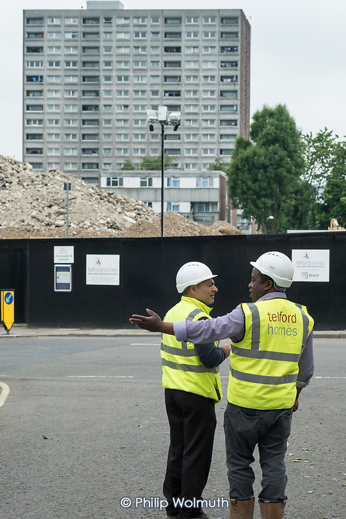 Telford Homes construction workers and the rubble from the demolition of Gloucester House, in front of the scheduled-for-demolition 18 storey Herefordshire House, South Kilburn Estate, London Borough of Brent.