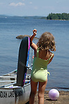 Girl in swimsuit, from back, place on beach at Indian Lake Islands, Adironaks.