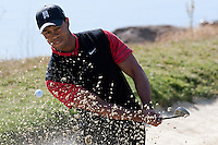 December 4, 2011: Tiger Woods hits out a bunker on the 3rd green  during the final round of the Chevron World Challenge held at Sherwood Country Club, Thousand Oaks, CA.