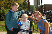 Kensington, MD - October 23, 2002 -- Julie Cramer, right, with 3 year-old Toby in stroller, and 5 year-old Hunt, a student at Oakland Terrace Elementary School in Kensington, MD walk home from school. <br /> Credit: Ron Sachs / CNP<br /> (RESTRICTION: NO New York or New Jersey Newspapers or newspapers within a 75 mile radius of New York City)
