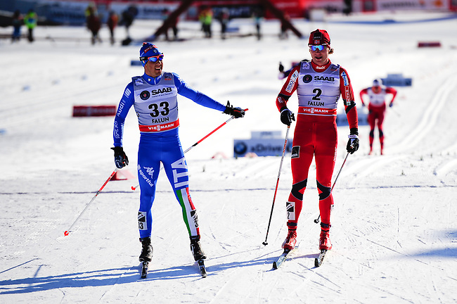 FALUN, SWEDEN - March 23: (L-R) Federico Pellegrino of Italy (ITA) and Eirik Brandsdal of Norway (NOR) finish at the Viessmann Men Classic Mass start 15km race at the FIS Cross Country World Cup Final on March 23, 2013 in Falun, Sweden. (Photo by Dirk Markgraf)