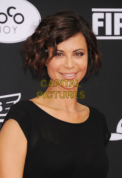 HOLLYWOOD, CA- JULY 15: Actress Catherine Bell arrives at the Los Angeles premiere of Disney's 'Planes: Fire &amp; Rescue' at the El Capitan Theatre on July 15, 2014 in Hollywood, California.<br /> CAP/ROT/TM<br /> &copy;Tony Michaels/Roth Stock/Capital Pictures