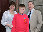 Ross Kinch from LeCheile school who was confirmed at St. Mary's church pictured with parents Paul and Louise. Photo: Colin Bell/pressphotos.ie