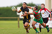 Heinie Fourie tries to collar Joe Heta as he gets the pass away. Counties Manukau Premier Club Rugby game between Waiuku and Bombay, played at Waiuku on Saturday July 5th 2010. Waiuku won 59 - 14 after trailing 12 - 14 at halftme.