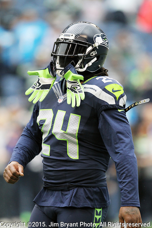 Seattle Seahawks running back Marshawn Lynch stands on the sidelines before their game against the Carolina Panthers  at CenturyLink Field in Seattle, Washington on October 18, 2015. The Panthers came from behind with 32 seconds remaining in the 4th Quarter to beat the Seahawks 27-23..  ©2015 Jim Bryant Photography. All Rights Reserved.