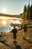 USA, Oregon, Paulina Lake, Brown Cannon, a fisherman and his son prepare to fish off the shoreline