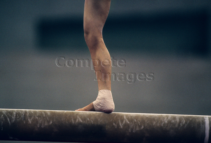 gymnast performing on beam