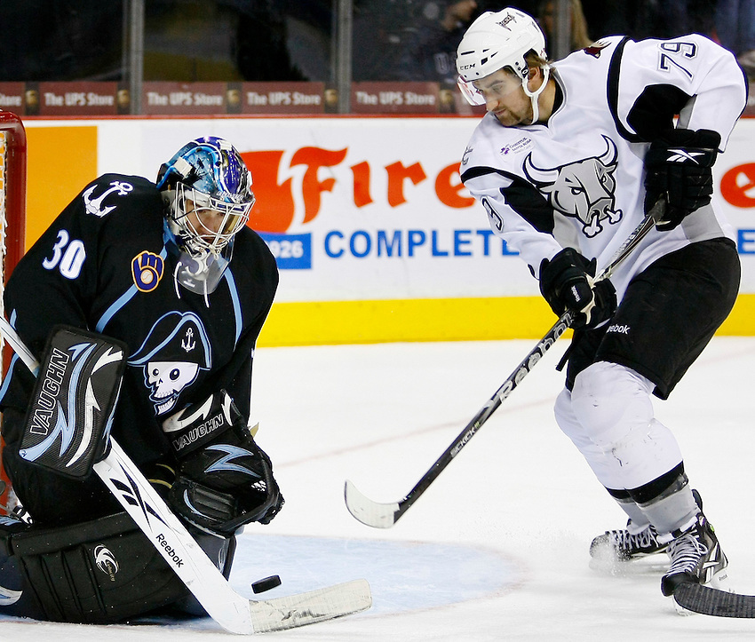 San Antonio Rampage's Brett MacLean, right, shoots on Milwaukee Admirals goaltender Jeremy Smith during the second period of an AHL hockey game, Sunday, Nov. 28, 2010, at the AT&T Center in San Antonio. (Darren Abate/pressphotointl.com)