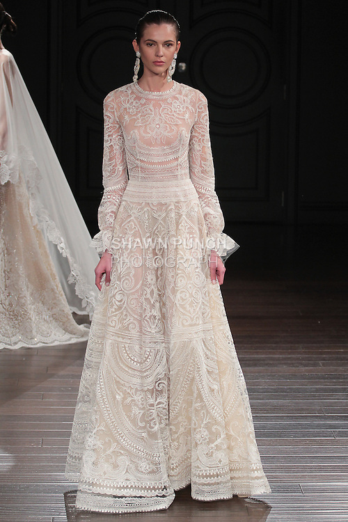 Model walks runway in a New Mexico bridal gown from the Naeem Khan Bridal Spring 2017 collection at 260 West 36 Street, during New York Bridal Fashion Week Spring Summer 2017 on April 16, 2016.