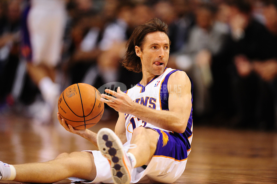 Mar. 27, 2011; Phoenix, AZ, USA; Phoenix Suns guard Steve Nash grabs a loose ball in the first half against the Dallas Mavericks at the US Airways Center. Mandatory Credit: Mark J. Rebilas-.
