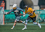 16 April 2016: University of Vermont Catamount Face Off specialist Luc LeBlanc, a Junior from Essex, VT, keeps ahead of UMBC Defender Tomas Rodriguez, a Freshman from Yorktown Heights, NY, during game action against the University of Maryland, Baltimore County Retrievers at Virtue Field in Burlington, Vermont. The Catamounts defeated the Retrievers 14-10 in NCAA Division I play. Mandatory Credit: Ed Wolfstein Photo *** RAW (NEF) Image File Available ***