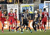 CHESTER, PA - AUGUST 12, 2012:  Amobi Okugo (14) of the Philadelphia Union stops a shot from  Alex (71) of the Chicago Fire during an MLS match at PPL Park, in Chester, PA on August 12. Fire won 3-1.