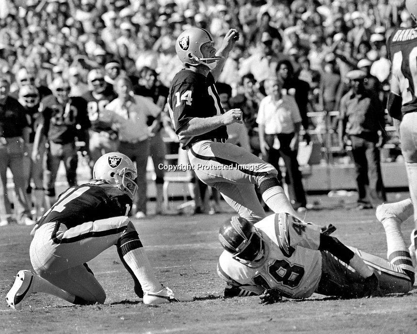 Oakland Raider Errol Mann kicks field goal from the Ken Stabler hold..against the San Diego Chargers.<br />